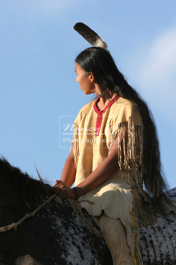 A Native American Indian boy riding bareback on a Indian horse on the prairie of South Dakota