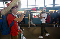 MOSCOW, RUSSIA - June 14, 2018: Mexico fans blow air horns at Vorobyovy Gory Metro Station before the opening match of the FIFA 2018 World Cup at Luzhniki Stadium.