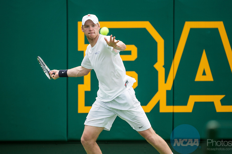 19 MAY 2015:  Mitchell Frank of the University of Virginia volleys during his match against Oklahoma's Andrew Harris during the Division I Men's Tennis Championship is held at the Hurd Tennis Center on the Baylor University campus in Waco, TX.  Virginia defeated Oklahoma 4-1 to win the team national title.  Darren Carroll/NCAA Photos