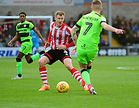Lincoln City's Michael O'Connor vies for possession with Forest Green Rovers' Carl Winchester<br /> <br /> Photographer Andrew Vaughan/CameraSport<br /> <br /> The EFL Sky Bet League Two - Lincoln City v Forest Green Rovers - Saturday 3rd November 2018 - Sincil Bank - Lincoln<br /> <br /> World Copyright &copy; 2018 CameraSport. All rights reserved. 43 Linden Ave. Countesthorpe. Leicester. England. LE8 5PG - Tel: +44 (0) 116 277 4147 - admin@camerasport.com - www.camerasport.com