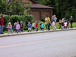 Pre-school children on outing with instructors and monitors