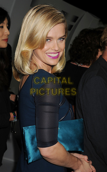 Alice Eve<br /> &quot;Star Trek Into Darkness&quot; DVD/Blu-Ray Release held at the California Science Center, Los Angeles, California, USA.<br /> September 10th, 2013<br /> full length blue dress black turquoise clutch bag stripe strips leather side <br /> CAP/ROT/TM<br /> &copy;Tony Michaels/Roth Stock/Capital Pictures