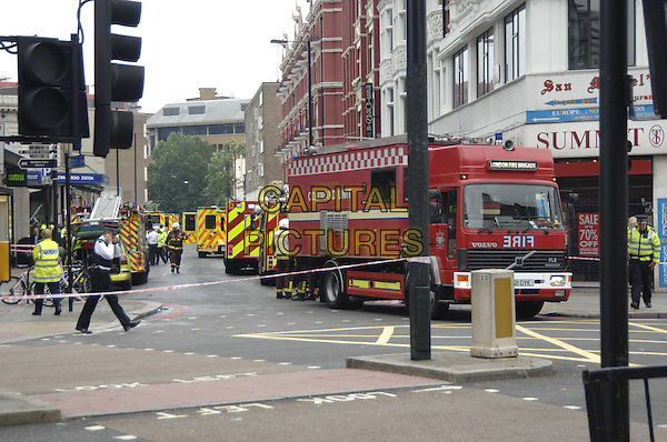 SCENE AT EDGEWARE ROAD TUBE STATION.Just after a reported explosion on the underground, London, July 7th 2005..general view fire engine emergency services police ambulances bomb blast.Ref: PL.www.capitalpictures.com.sales@capitalpictures.com.©Capital Pictures