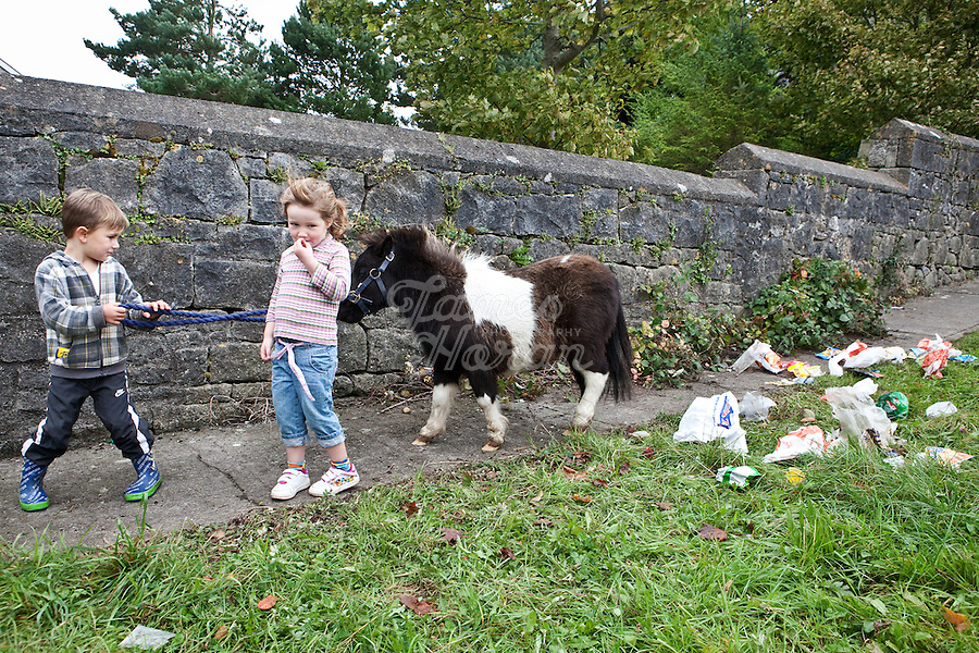 4/10/2010. A traveler boy and girl play with their pony near the camp site at the Ballinasloe Horse Fair, Ballinasloe, Ireland. Picture James Horan
