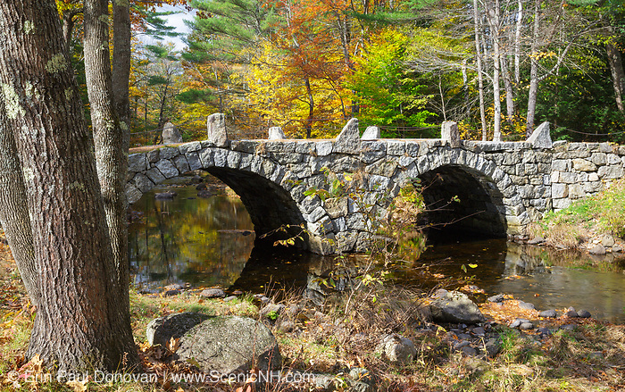 A stone double arch bridge which spans Beard Brook at the meeting of Beard and Jones Road in Hillsborough, New Hampshire during the autumn months. Known as the Old Carr Bridge, built by Captain Jonathan Carr in 1840.