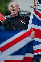 Saturday 05 April 2014<br /> Pictured: A White pride protester shout at anti fascist supporters in the road opposite <br /> Re: White Pride and Anti Fascist groups protest in Swansea City Cebtre