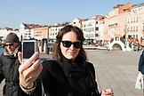 ITALY, Venice. Aritst Mia Kaplan taking a selfie.