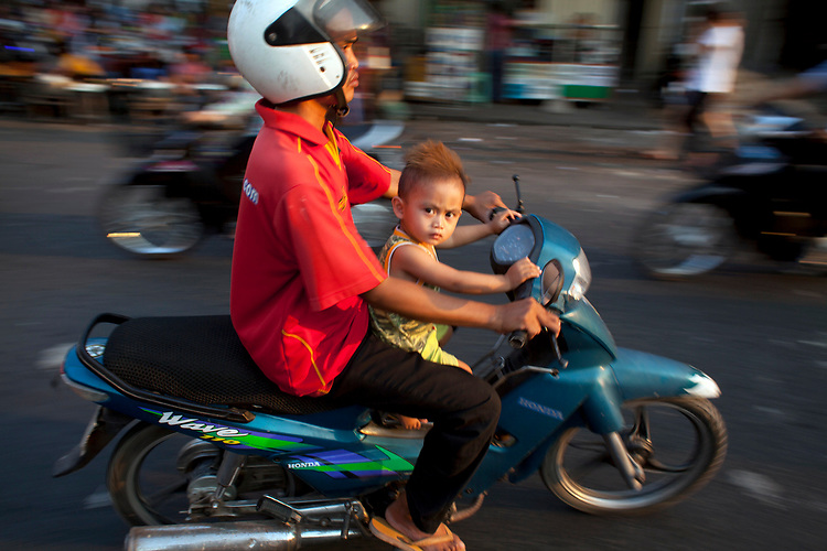 Bikes and motorbikes on the busy streets of Phnom Penh, Cambodia. <br /> <br /> Photos &copy; Dennis Drenner 2013.