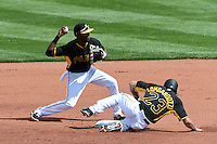Pittsburgh Pirates second baseman Alen Hanson (63) throws to first as Steve Lombardozzi (23) slides into second during the Black & Gold intrasquad game on March 2, 2015 at McKechnie Field in Bradenton, Florida.  (Mike Janes/Four Seam Images)