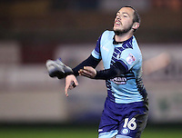 Michael Harriman of Wycombe Wanderers returns a trainer to the bench after one of the staff lost it kicking a ball back into play <br /> <br /> during the Sky Bet League 2 match between Accrington Stanley and Wycombe Wanderers at the wham stadium, Accrington, England on 28 February 2017. Photo by Tony  KIPAX.