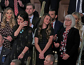 Heather Armstrong wipes away a tear as she and Madison Armstrong and Debra Bissell are introduced by United States President Donald J. Trump during his second annual State of the Union Address to a joint session of the US Congress in the US Capitol in Washington, DC on Tuesday, February 5, 2019.  They represent three surviving generations of the family of Gerald and Sharon David of Reno, Nevada, who were murdered in their home by an illegal immigrant in January 2019.  Pictured behind Ms. Armstrong are Lara Trump, left and Eric Trump, right. <br /> Credit: Alex Edelman / CNP