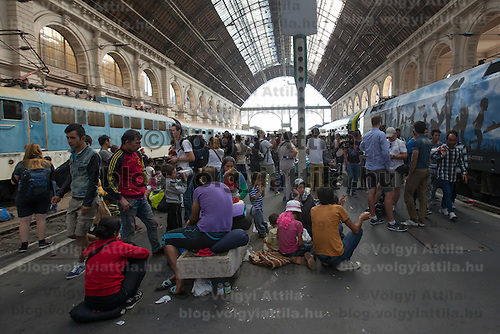 Illegal migrants wait on the platform to board a train in hopes to leave for Germany at the main railway station Keleti in Budapest, Hungary on September 03, 2015. ATTILA VOLGYI