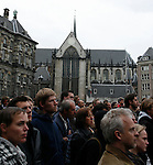 Attendees at the Dam Square observe a minute's silence during the World War II Remembrance Day Ceremony in Amsterdam May 4th 20009. ..The Dutch Queen Beatrix attended, under heavy security and sniper cover following an attempted attack on the Royal Family on Queens Day in Apeldoorn