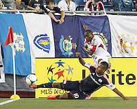 New England Revolution midfielder Juan Agudelo (10) blocks clear effort by D.C. United substitute forward Sainey Nyassi (27). In a Major League Soccer (MLS) match, the New England Revolution (blue) tied D.C. United (white), 0-0, at Gillette Stadium on June 8, 2013.