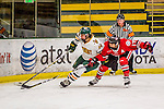 25 November 2016: University of Vermont Catamount Forward Saana Valkama, a Sophomore from Pirkkala, Finland, skates for possession against Saint Cloud State Huskie Defender Jenna Redford, a Redshirt Senior from Soldotna, Alaska, at Gutterson Fieldhouse in Burlington, Vermont. The Lady Cats defeated the Huskies 5-1 to take the first game of the 2016 Windjammer Classic Tournament. Mandatory Credit: Ed Wolfstein Photo *** RAW (NEF) Image File Available ***