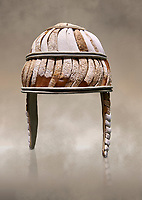 Minoan boar's tusk helmet with cheek guards,1450-1300 BC, Heraklion Archaeological Museum.  More below......<br /> <br /> This restored boars tusk helmet was described in Homers Iliad being worn by Cretan hero Meriones. It bis believed that the helmet was ceremonial depicting the rank of an officer.