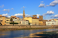 """The  beautiful  view of the city from the Florentine  riverbank Arno on to  the""""Santa Croce """"church tower."""