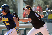 Bethune-Cookman Wildcats pitcher Bailey Connor (25) tags out shortstop Sierra Romero (32) in a run down during a game against the Michigan Wolverines on February 9, 2014 at the USF Softball Stadium in Tampa, Florida.  Michigan defeated Bethune-Cookman 12-1.  (Copyright Mike Janes Photography)