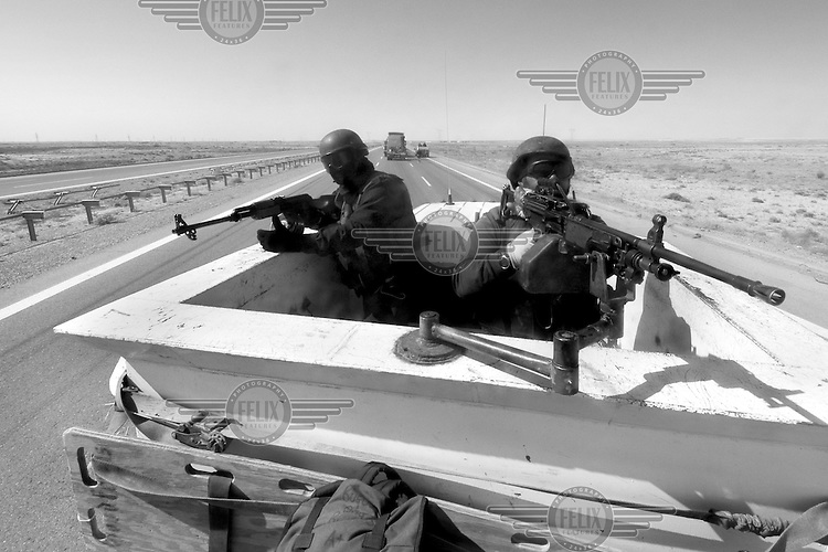Private security operators from the British company ArmorGroup escort a supply convoy near Al Asad air base on October 17, 2006.  The coalition forces and civilian administration in Iraq depend heavily on thousands of controversial security contractors to support their reconstruction efforts and military operations.