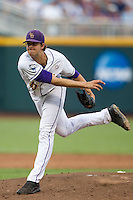 LSU Tiger pitcher Aaron Nola (10) follows through on his delivery to the plate during Game 4 of the 2013 Men's College World Series against the UCLA Bruins on June 16, 2013 at TD Ameritrade Park in Omaha, Nebraska. UCLA defeated LSU 2-1. (Andrew Woolley/Four Seam Images)