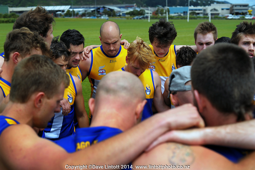 The Otago team huddles before the Wellington Australian Rules Football National Provincial Championship final match between the Canterbury Cobras (black and red) and Otago Riot (blue and gold) at Hutt Park, Wellington, New Zealand on Saturday, 6 December 2014. Photo: Dave Lintott / lintottphoto.co.nz