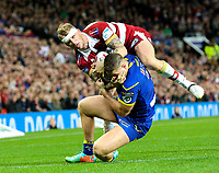 Wigan Warriors' Dominic Manfredi competes with Warrington Wolves 's Tom Lineham for the ball<br /> <br /> Photographer Alex Dodd/CameraSport<br /> <br /> Betfred Super League Grand Final - Wigan Warriors v Warrington Wolves - Saturday 13th October 2018 - Old Trafford - Manchester<br /> <br /> World Copyright © 2018 CameraSport. All rights reserved. 43 Linden Ave. Countesthorpe. Leicester. England. LE8 5PG - Tel: +44 (0) 116 277 4147 - admin@camerasport.com - www.camerasport.com
