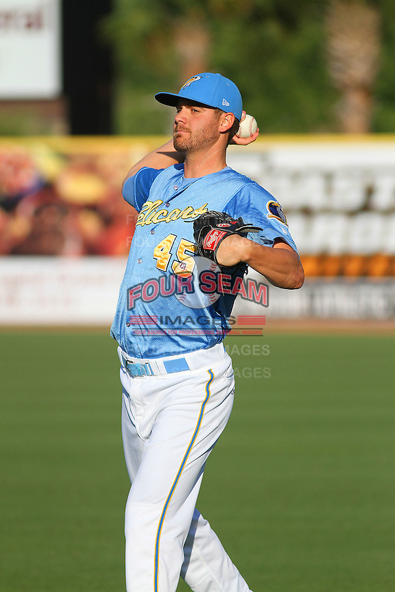 Myrtle Beach Pelicans pitcher Zach Osborne #45 warming up in the outfield before a game against the Frederick Keys at Tickerreturn.com Field at Pelicans Ballpark on April 24, 2012 in Myrtle Beach, South Carolina. Frederick defeated Myrtle Beach by the score of 8-3. (Robert Gurganus/Four Seam Images)