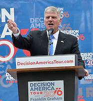 4/13//16 Jackson,MS. Evangelist Franklin Graham, Billy Graham's son, speaks on the steps of the Mississippi Capital. Graham held a prayer service Wednesday afternoon as part of his Decision America Tour 2016, where Graham is calling on all Christians to vote. Graham wants all Christians to vote with their religious beliefs and vote Christians into all public offices. Graham's visit comes days after Mississippi Governor passed a controversial Religious Freedom law. Governor Phil Bryant and first Lady Deborah Bryant sat on the Capitol step listening to Franklin and prayed with him. Photo ©Suzi Altman