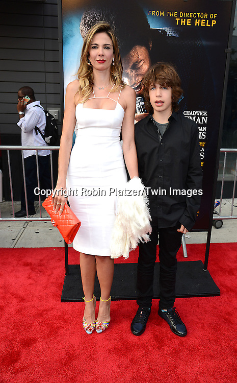 "Luciana Marad and son Lucas Jagger attend the World Premiere of ""Get On Up"" at the Apollo Theater in Harlem in New York Citiy on July 21, 2014."