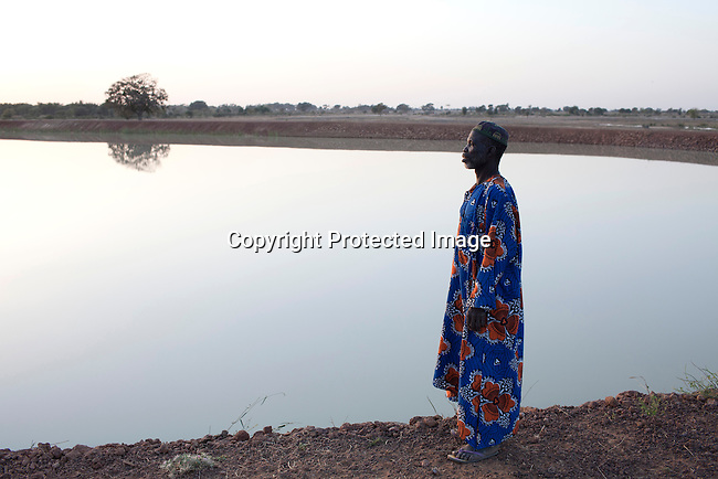 TANGAKA, MALI - FEBRUARY 24:  Mori Fofana, a farmer looks at the land that was taken from him when the channel was built by Chinese for Libyan company that leases land from the Mali government on February 24 2011, outside Tangaka, Mali. Photo by Per-Anders Pettersson