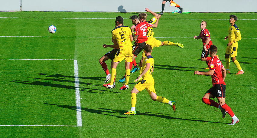 Lincoln City's Adam Jackson scores his side's second goal<br /> <br /> Photographer Chris Vaughan/CameraSport<br /> <br /> The EFL Sky Bet League One - Saturday 12th September 2020 - Lincoln City v Oxford United - LNER Stadium - Lincoln<br /> <br /> World Copyright © 2020 CameraSport. All rights reserved. 43 Linden Ave. Countesthorpe. Leicester. England. LE8 5PG - Tel: +44 (0) 116 277 4147 - admin@camerasport.com - www.camerasport.com - Lincoln City v Oxford United