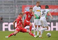 13th June 2020, Allianz Erena, Munich, Germany; Bundesliga football, Bayern Munich versus Borussia Moenchengladbach;  Michael Cuisance (Bayern)stabs the ball away from Florian Neuhaus (Borussia Mönchengladbach)