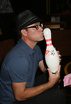 Robert Bogue signs bowling pin for charity at Meet & Greet - Day 2 - August 1, 2010 - So Long Springfield at Sea aboard Carnival's Glory (Photos by Sue Coflin/Max Photos)