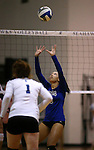 Marymount's Zacharie Jackson sets in a college volleyball game against St. Mary's in Lexington Park, MD, on Wednesday, Oct. 29, 2014. Marymount won 3-2 to go 24-9 on the season.<br /> Photo by Cathleen Allison