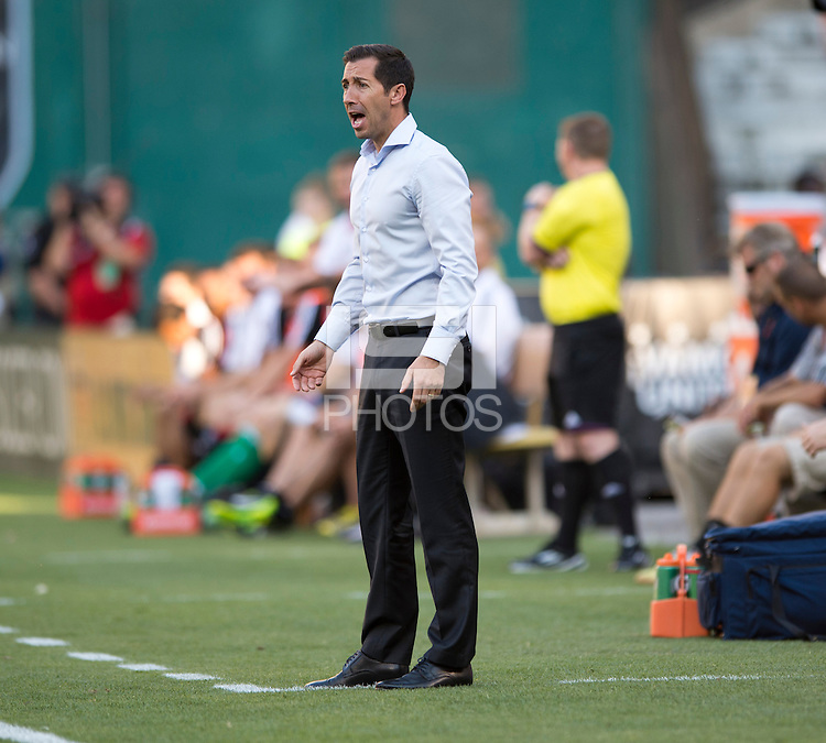 Vancouver Whitecaps head coach Martin Rennie yells to his team during a Major League Soccer match at RFK Stadium in Washington, DC. D.C. United lost to the Vancouver Whitecaps, 1-0.