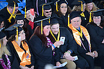 Graduates check out a photo during the 2015 Western Nevada College Commencement held at the Pony Express Pavilion in Carson City, Nev., on Monday, May 18, 2015.<br /> Photo by Tim Dunn