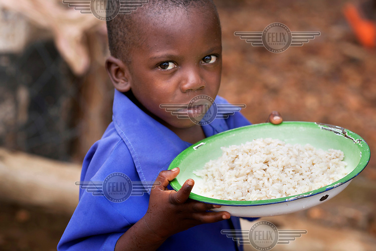 A boy with his lunch at Zvehuru primary school.