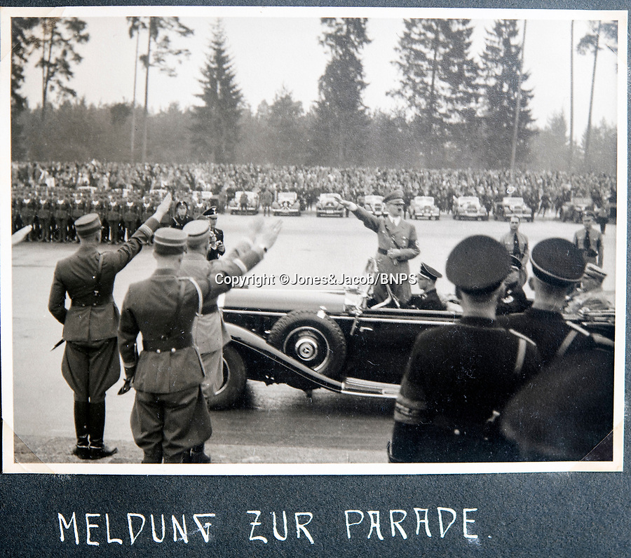 BNPS.co.uk (01202 558833)<br /> Pic: Jones&Jacob/BNPS<br /> <br /> Hitler on parade.<br /> <br /> Springtime for Hitler...Chilling album of pictures taken by one of Hitlers bodyguards illustrates the Nazi dictators rise to power.<br /> <br /> An unseen album of photographs taken by a member of Hitlers own elite SS bodyguard division in the years leading up to the start of WW2.<br /> <br /> The 1st SS Panzer Division 'Leibstandarte SS Adolf Hitler' or LSSAH began as Adolf Hitler's personal bodyguard in the 1920's responsible for guarding the Führer's 'person, offices, and residences'.