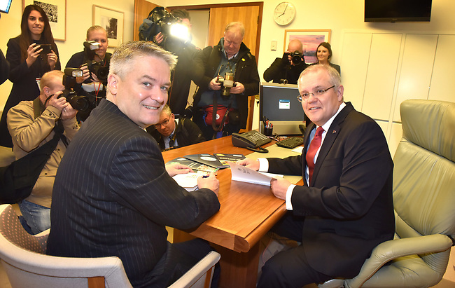 Australian Treasurer Scott Morrison (R) and Finance Minister Mathias Cormann (L) are pictured with the budget papers at Parliament House in Canberra, Australia, on Tuesday, May 9, 2017.  Photographer: Mark Graham/Bloomberg