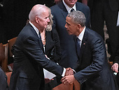 Former United States President Barack Obama, right, shakes hands with former United States Vice President Joe Biden, left, following the National funeral service in honor of the late former US President George H.W. Bush at the Washington National Cathedral in Washington, DC on Wednesday, December 5, 2018.<br /> Credit: Ron Sachs / CNP<br /> (RESTRICTION: NO New York or New Jersey Newspapers or newspapers within a 75 mile radius of New York City)