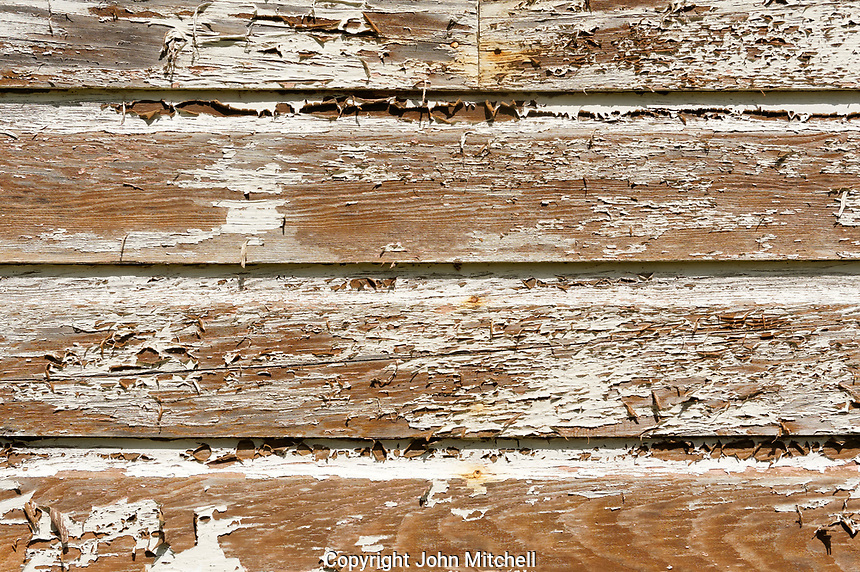 Weathered wooden siding with peeling paint