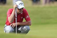Marc Warren (SCO) lines up his putt on the 14th green during Thursday's Round 1 of the 145th Open Championship held at Royal Troon Golf Club, Troon, Ayreshire, Scotland. 14th July 2016.<br /> Picture: Eoin Clarke | Golffile<br /> <br /> <br /> All photos usage must carry mandatory copyright credit (&copy; Golffile | Eoin Clarke)