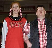 RICK PECK/SPECIAL TO MCDONALD COUNTY PRESS<br /> Senior king candidate John Gordon is escorted by Alexia Kitlen.