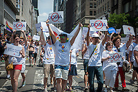 Members of the Empire State Pride Agenda join thousands of marchers and spectators at the 44th annual Lesbian, Gay, Bisexual and Transgender Pride Parade on Fifth Avenue in New York on Sunday, June 30, 2013. The turn out for the parade was especially large with the recent Supreme Court decision overturning the Defense of Marriage Act (DOMA) and California's Proposition 8. Edie Windsor, the Grand Marshal, was the lead plaintiff in the case that resulted in the over turning of DOMA. (© Richard B. Levine)
