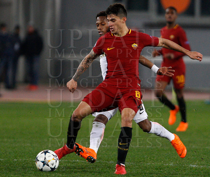 Roma s Diego Perotti, foreground, is challenged by Shakhtar Donetsk's Fred during the Uefa Champions League round of 16 second leg soccer match between Roma and Shakhtar Donetsk at Rome's Olympic stadium, March 13, 2018. Roma won. 1-0 to join the quarter finals.<br /> UPDATE IMAGES PRESS/Riccardo De Luca
