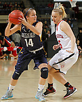 RAPID CITY, S.D. -- DECEMBER 7, 2013 -- Jordan Needens #14 of South Dakota Mines looks past University of South Dakota defender Nicole Seekamp #35 during their game Saturday at the Rushmore Plaza Civic Center Ice arena in Rapid City, S.D.  (Photo by Dick Carlson/Inertia)