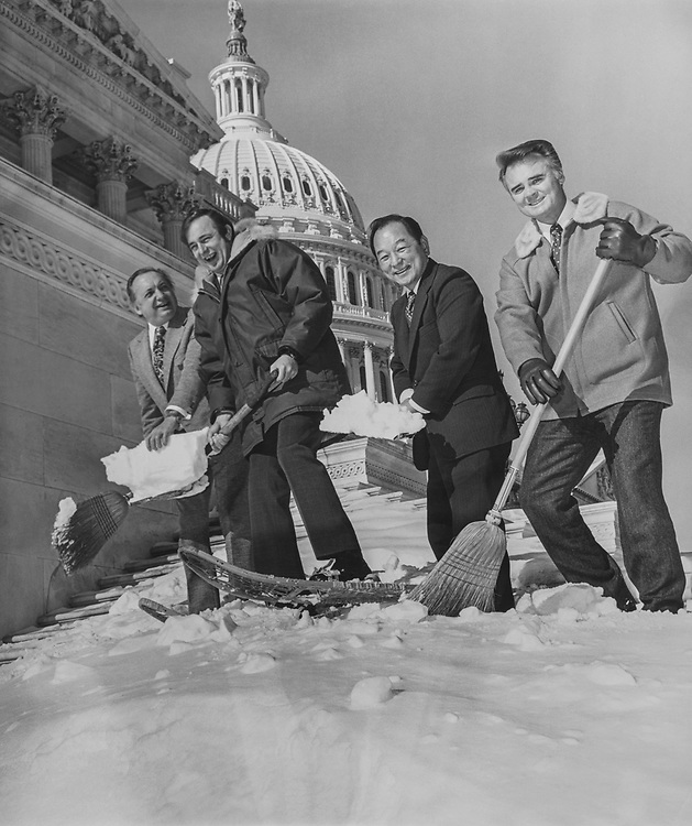 Rep. Don Young, R-Alaska, with parka snow shoes and a shovel of snow, shows how to handle the white stuff to Rep. Bob Wilson, San Diego, R-Calif., Rep. Spark Matsunaga, D-Hawaii, and Rep. Bill Young, R-Fla. 1973 (Photo by Mickey Senko/ CQ Roll Call via Getty Images)