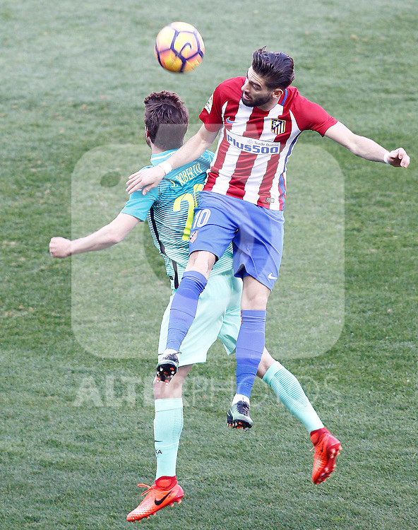 Atletico de Madrid's Yannick Ferreira Carrasco (r) and FC Barcelona's Sergi Roberto during La Liga match. February 26,2017. (ALTERPHOTOS/Acero)