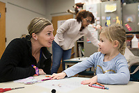 "NWA Democrat-Gazette/CHARLIE KAIJO Bethany Koenig of Rogers (left) praises daughter Parker Koenig, 4, after completing an exercise writing the letter ""k"", Monday, November 4, 2019 during the weekly Storytime Express at the Rogers Public Library in Rogers.<br /> <br /> Storytime Express is a weekly early education program designed to help kids ages 3 to 5 develop the skills needed to succeed in kindergarten. Educators use pictures, songs, stories and crafts exercise to help kids develop cutting and writing skills and practice their letters and the way they sound. Kids also learn how to socialize in a classroom setting. This week they learned about the letter ""k"" and created cutout koalas to practice sounding out the letter. ""When they first start out, they don't know how to do a lot of stuff but you see them improve which is neat"" said Dara Stine, assistant children's director."