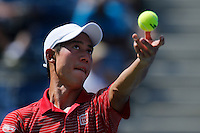 Kei Nishikori of Japan serves to Novak Djokovic of Serbia during men semifinal match at the US Open 2014 tennis tournament in the USTA Billie Jean King National Center, New York.  09.05.2014. VIEWpress